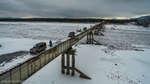 Один из самых опасных автомобильных мостов в мире,Entertainment,Bridge (Literature Subject),Витим,Автомобильный мост через реку Витим местные сжигали зачем-то аж два раза. Он идет параллельно БАМовскому ЖД мосту и считается одним из самых опасных автомобильных мостов в мире (входит в десятку). Его